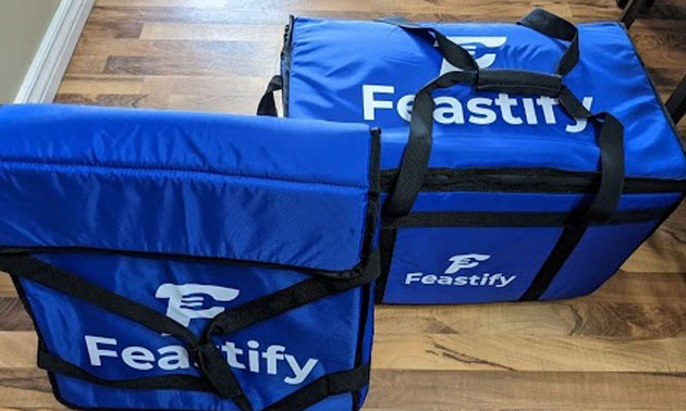 Blue Feastify branded delivery bags.