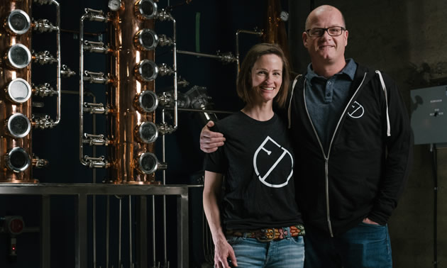 Jillian Rutherford and Andrew Hayden stand at the heart of their new business, Fernie Distillers in Fernie, B.C.