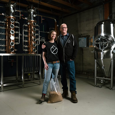 Owners of Fernie Distillers standing in their distillery room.