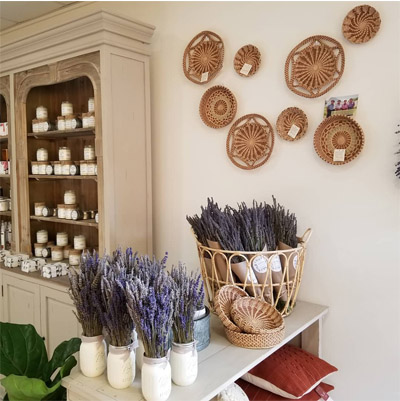Interior of Sanctuary Lavender shop, showing bouquets of lavender and artisan crafts and candles.