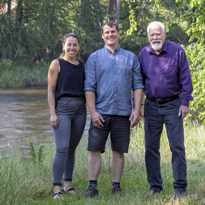 Emmeline Marshall-Hill, Graham Watt and Brian Taylor, on the shore of the Granby River, Grand Forks, B.C.