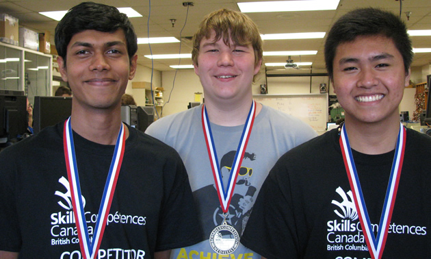 MBSS students Ravinder Ranasinghe, Adam Webster and Joshua Zamora are 2015 Skills Canada B.C. gold medal winners in robotics.