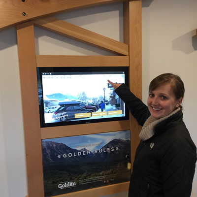 Alycia Weir, manager of the VISAH, demonstrates the new digital kiosk.
