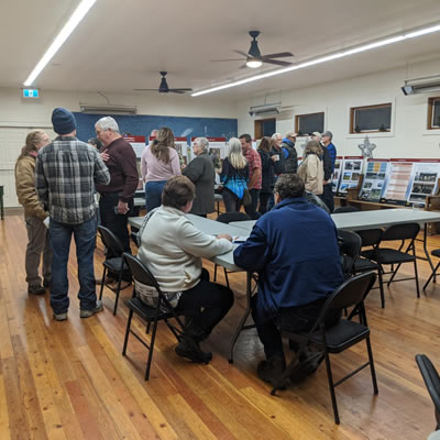 Community members discuss Koocanusa recreation at the Grasmere open house.