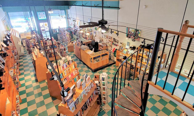 Interior of Grizzly Book & Serendipity Shop, shelves of books, tiled floor.