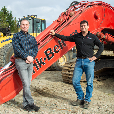 Caliper Machine & Hydraulics owner Mike Hambalek (left) and Troy Ross, Caliper GM, are shown here with some of the heavy equipment that comes to them for repair.