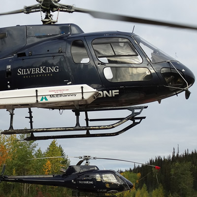 Close-up of two helicopters at low altitude