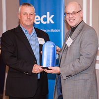 Larry Davey, General Manager of Teck's Elkview Operations, accepts the Towards Sustainable Mining Leadership Award from Pierre Gratton, President and CEO of the Mining Association of Canada, at a celebration event in Sparwood on November 28.