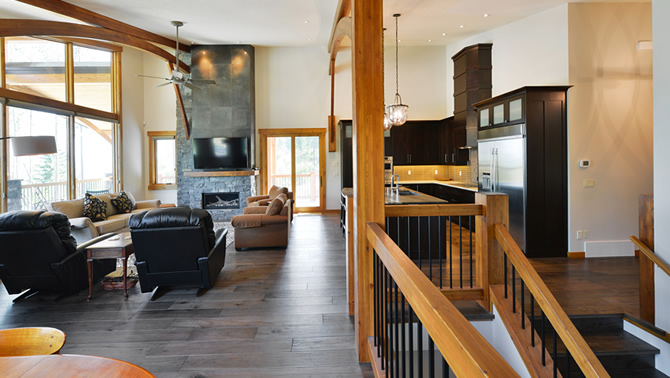 The interior of an energy-efficient home built by Tyee Custom Homes in Kimberley, B.C., showing the long view to the fireplace.
