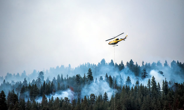 Helicopters fighting forest fires in Kootenays, B.C. in August, 2018.