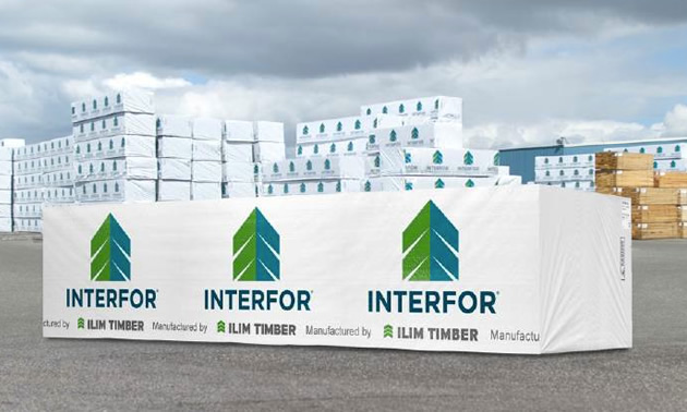 Picture of lumber stacked in yard, covered with Interfor logo.
