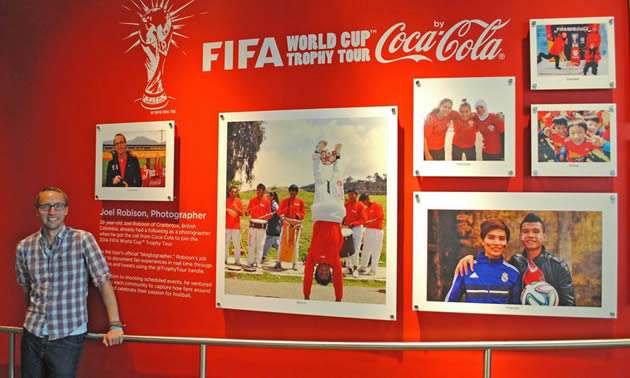Joel Robison with a display of his photos at the Coca-Cola museum in Atlanta, Georgia