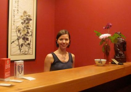 Woman at a front desk of an office
