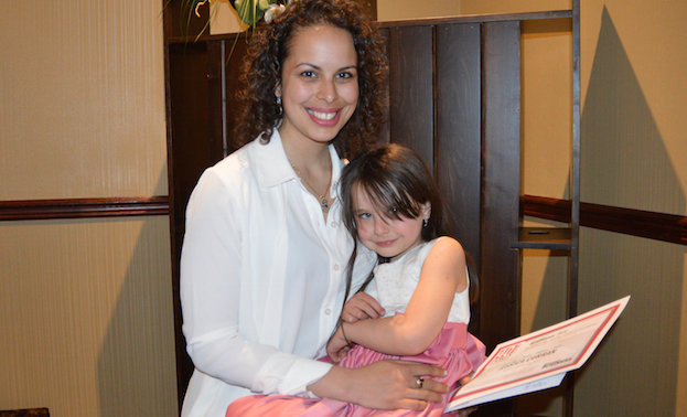 Jessica Curran, owner of Primary Choice Homes Corp., in Nelson, B.C., is posing with her daughter Cai.
