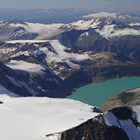 Photo of Grant Costello skiing Farnham Glacier at Jumbo Glacier Resort with French technical team.