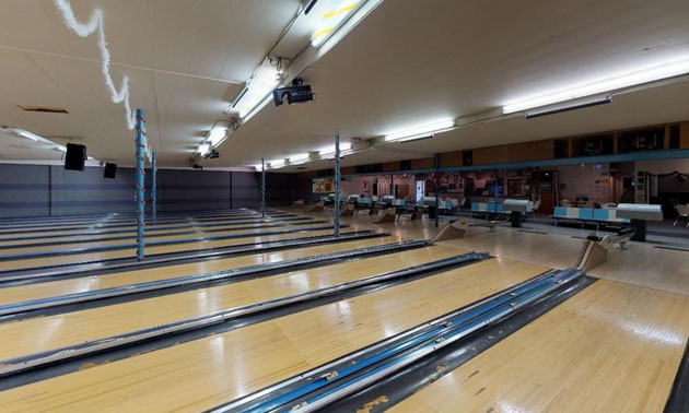 Interior picture of bowling lanes.
