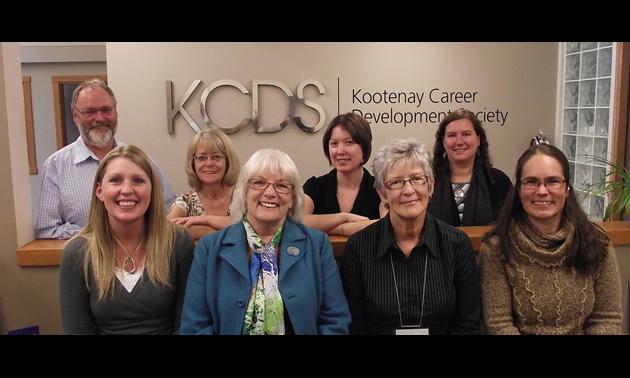 Kootenay Career Development Society – Castlegar Employment Services Centre Staff. From Left to right, back row: Bob Wright, Susan Deadmarsh, Tara Thom, Jessica Lunn. Front Row: Joanna Swanson-Kutasewich, Jan Wright, Leni Normington, Katt Britton.