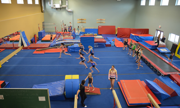Group of girls doing running exercises in a gymnastics facility