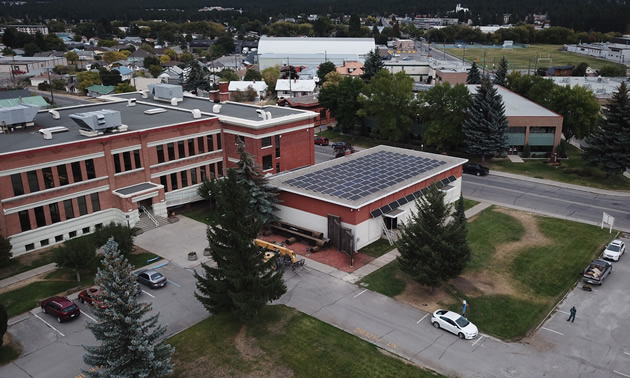 Aerial view of the solar power installation on the roof of the Ktunaxa Nation Council auditorium.