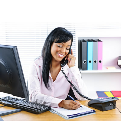 Picture of woman talking on phone in office setting