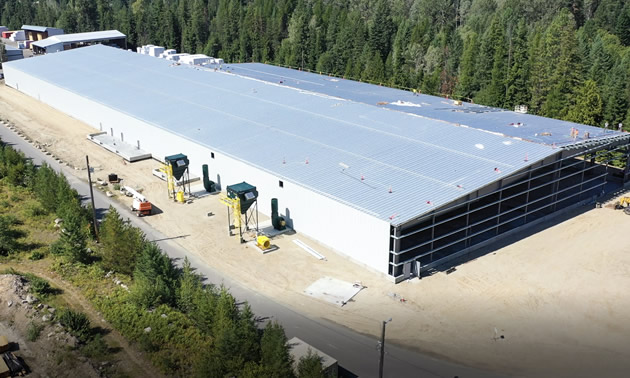 The partially built mass timber is shown, fully enclosed. It will begin partial operations later this year.