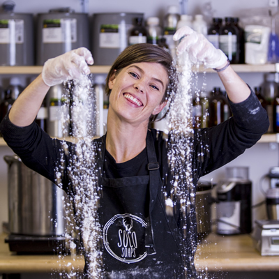 WIth a big smile, Karey Pion is mixing a tub of ingredients.