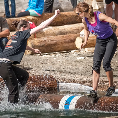 Two young women try their skills at logrolling during Logger Sports in Kaslo, B.C.
