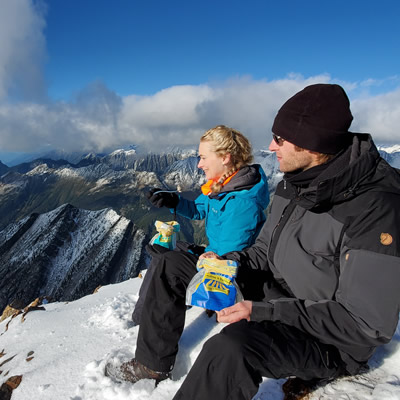 Heidi Lettrari, general manager, and Stefan Lettrari, production manager, of Kaslo Sourdough enjoy a tasty snack while perched on top of a local peak.