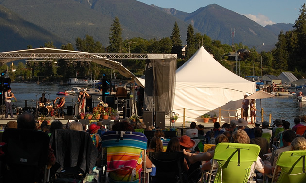 A view of the floating stage on Kootenay Lake with the Purcell Mountains in the distance.