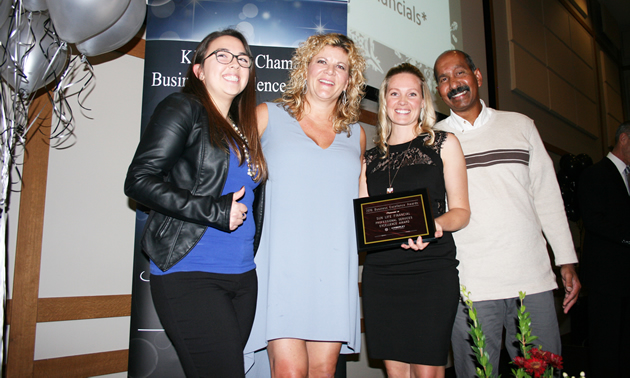 (L to R) Bronte Dickson of Kootenay Business magazine presents the Professional Services Award to Sun Life Financial's Karly Berry and Rachelle Colthorp, with Kimberley chamber director Thomas Datt