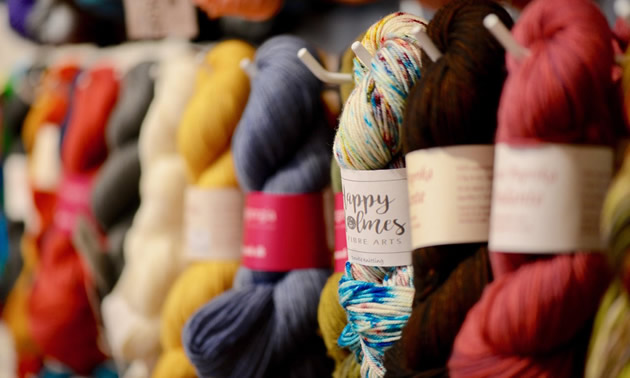 A close-up of colorful skeins of yarn
