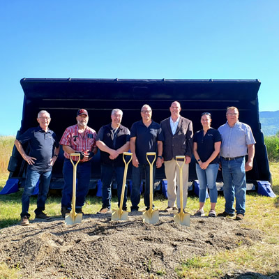 Sparwood Mayor and Council at Komatsu Mining groundbreaking ceremony. Left to right: Councillor Brad Bowen, Councillor Ron Saad, Councillor John Baher, Councillor Joe Jarina, Mayor David Wilks, Councillor Amy Cardozo and Councillor Jason Christensen.