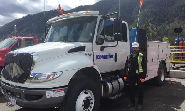 Steven Drost with a new Komatsu service truck.