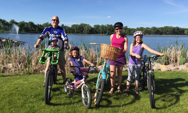 Kristy Jahn-Smith and her family on bikes on sunny day.