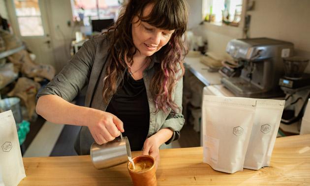 Illana Cameron pouring coffee into cup.