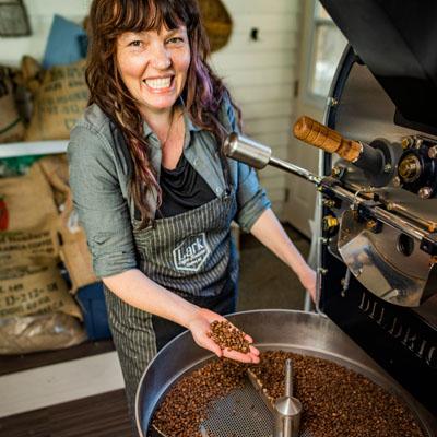 Ilana Cameron roasting coffee beans.