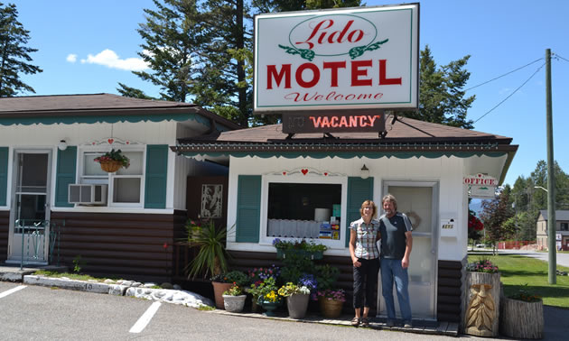 Owners Gabriele and Frank Lorenz are standing in front of the Lido Motel in Radium Hot Springs, B.C.