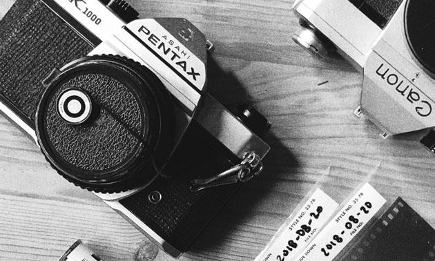Black and white photo of camera equipment.