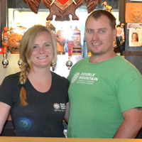 Carly Hadfield and Troy Pyett behind the bar at the Lion's Head pub in Castlegar