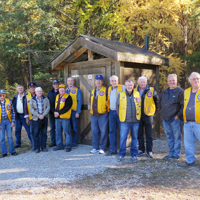 Members of the Cranbrook Lions are pictured in front of one of the four wheelchair-accessible outhouses they recently constructed for Wycliffe Regional Park.