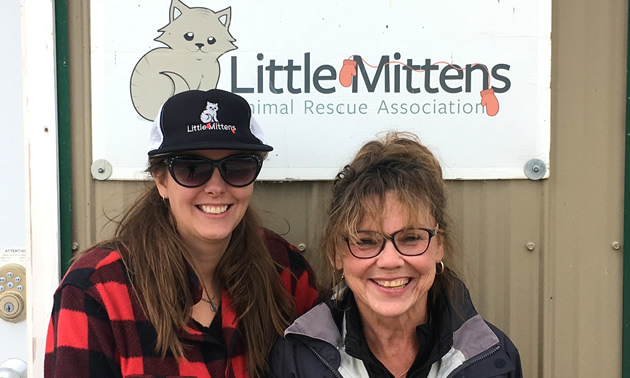 Alannah Knapp and volunteer Linda Niemi stand in front of the Little Mittens Animal  Rescue Association's building.