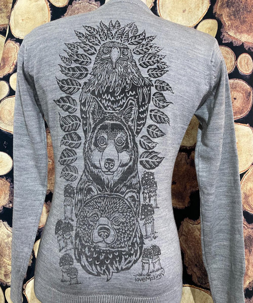 Grey sweater with detailed hand-drawn picture.