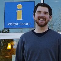 Mark Rossi, a UBC Okanagan student, outside the Revelstoke visitors' centre