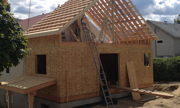 A building is framed and trusses are up.