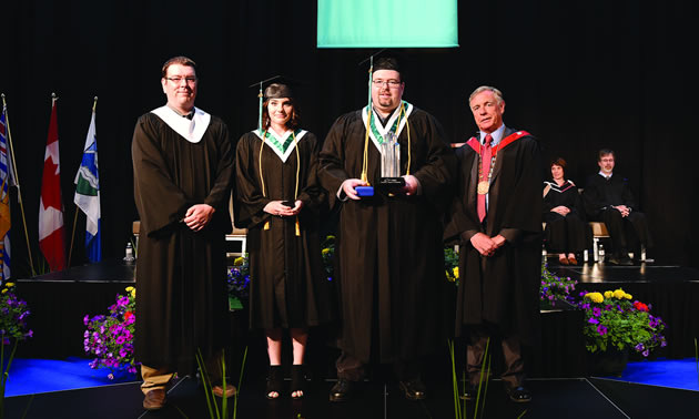 (l-r) College of the Rockies' Board of Governors Chair, Jesse Nicholas, Lieutenant Governor's Medal recipient, Skyla Gronen, and Governor General's Bronze Medal and President's Award of Excellence recipient, Bradley Schmidt joined College President and CEO David Walls at the June 8 Convocation ceremony.