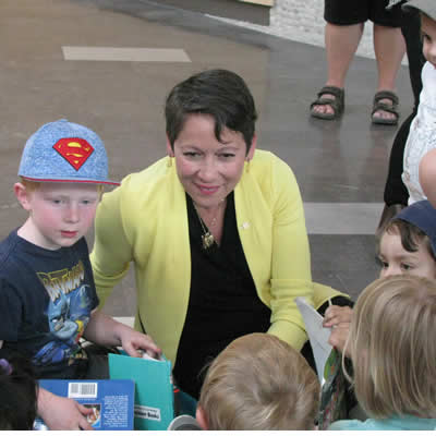Melanie Mark, minister of advanced education, skills and training, listens to children enrolled in the Early Childhood Education Program at College of the Rockies on May 25, 2018.