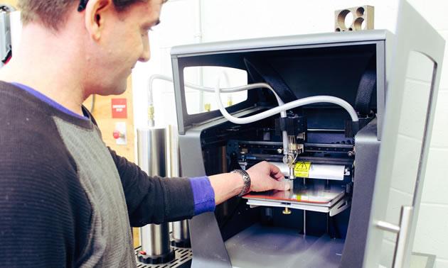 Close up of inside of metal printer.