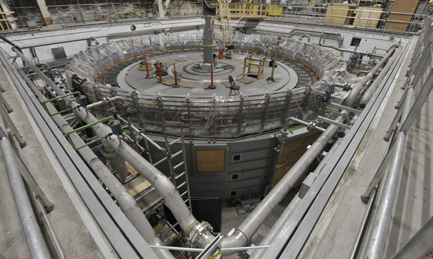A generator nearing completion at Mica Generating Station, before the generator covers are installed