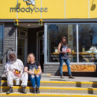 Owner and staff outside Moody Bee in Kimberley's Platzl.