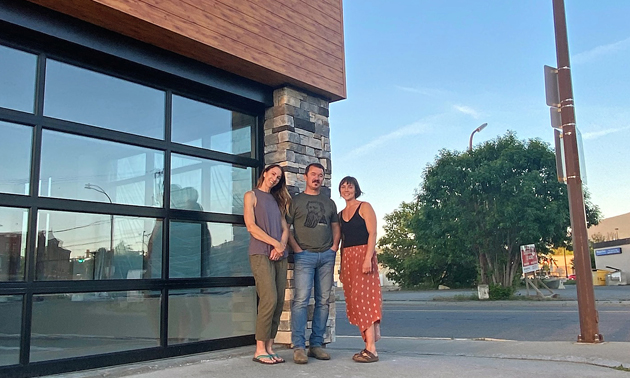 (L to R) Corinna Robinson, Mike Robinson and Christel Hagn stand in front of the Morchella Market building.